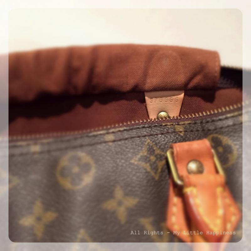 Designer vintage tas LV binnenkant